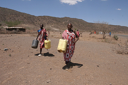 Walking a round trip of up to 100 km (62 miles) to fetch water in north eastern Kenya