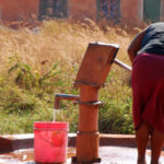 woman and clean water pump in africa