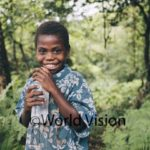 Boy in Tanna Vanuatu with clean water